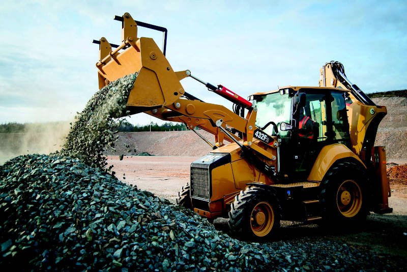 Excavator dumping rocks