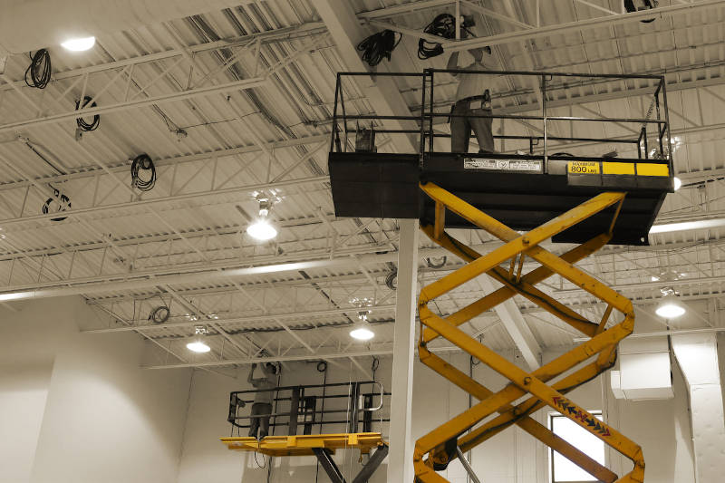 Industrial electricians on scissor lift